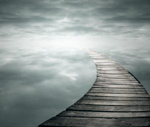 Beautiful poetic background with a wooden footbridge into the infinity sky