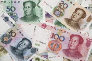 Background collage of Chinese Rmb bank notes or Yuan with Chairman Mao on the front of each bill